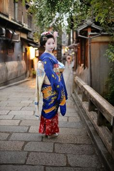 Maiko Mamekiku is a known actress in Japan. In this photo she is wearing Japanese fashion, with her face painted white. Many fans of her claim that she has a ageless face.