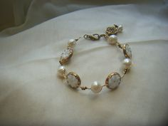 Silhouette Jewelry FB  Vintage glass buttons and freshwater pearls.