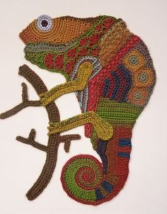 Freeform crocheted kameleon on framed canvas