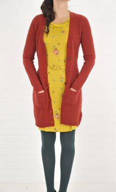 Model wears the Ines dress Moneypenny with the Cardi long Spiral naps.