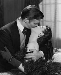 Lo que el viento se llevo.  Filme de 1939, actores Clark Gable interpretando a Rhett Butler y Vivien Leigh en Scarlett O'Hara