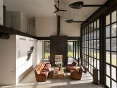 Studio Sitges-Olson Kundig Architects-10-1 Kindesign.  Handmade sconces, installed high above the double volume space. They were designed on a sheet metal shaper by a sculptor of Harley Davidson fenders and gas tanks & given a blackened finish