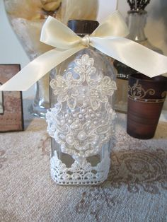 romantic country with bottle decorated with wedding gown detailing