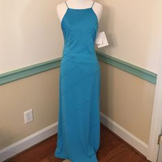 NWT DeLaru Blue (7/8) Prom Formal Dress New with tags excellent condition prom or formal dress. Ties in back with beautiful beads  Size 7/8 zips down side, 100% polyester!!! Delaru Dresses Prom