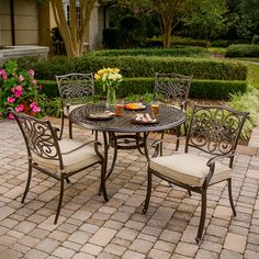 Hanover Traditions Bronze Frame Patio Set with Natural Oat Cushions at Lowe's. The traditionally designed Hanover patio set beautifully transforms any backyard into an elegant outdoor dining area with its Dining Furniture Sets, 4 Dining Chairs, Outdoor Dining Set, Outdoor Furniture Sets, Outdoor Decor, Patio Dining, Round Dining, Dining Table, Dining Area