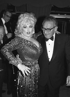 Dolly Parton This 1985 picture says it all: even Henry Kissinger couldn't resist gawking at Parton's famous assets