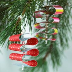 Add a splash of color to your Christmas tree decor with a DIY ornament the kids can help with. Thread a needle with embroidery floss and knot at one end. Add one clear bead to the floss, then poke the needle through the end of a 1-inch-wide strip of colorful paper. Continue by alternating two clear beads and a loop of the paper strip.