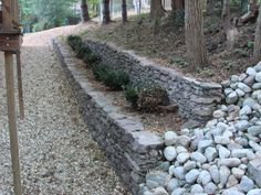 Stone retaining wall. Repin for #landscaping inspiration | Drainage and Erosion Solutions