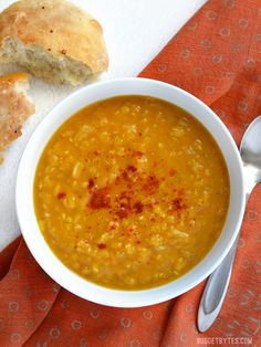 This super fast and easy Curried Red Lentil and Pumpkin Soup is soul warming and flavorful. Customize with your favorite toppings! - BudgetBytes.com