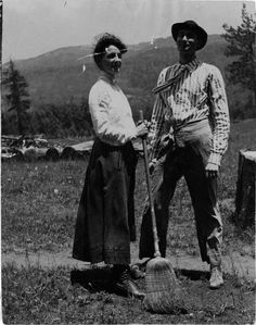Durango (Colo.)  ~  A man and woman standing outside with an broom.  Center of Southwest Studies, Fort Lewis College