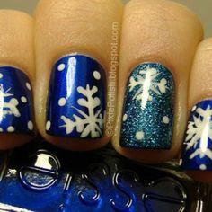 Nail, nail, nail. snowflake nail art diy blue nail polish sparkles accent nail essie white and blue