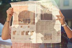 Silhouette through a newspaper