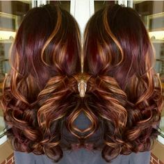 Really cute burgundy hair with caramel highlights