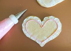 How to Make Lace-Trim Decorated Cookies | Bake at 350° Pink Icing, White Icing, Heart Cookies, Cut Out Cookies, Icing Tips, Valentines Day Cookies, Icing Recipe, Royal Icing Cookies, Decorated Cookies