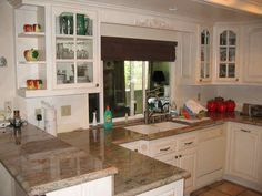 I like the raised breakfast bar and the cabinets with shelving to the side.