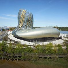This huge bulbous building by XTU Architects creates a wine museum on the Bordeaux riverfront. Open since the end of May, La Cité du Vin is a major new tourist attraction for the French city, boasting cavernous exhibition halls and a 55-metre-high viewing tower. Find out more about this museum on dezeen.com/tag/museums #architecture #France #Bordeaux #museums Photography is by Julien Lanoo.