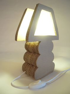 This lamp is hand-made just from recycled cardboard boxes. Its sides of corrugated cardboard creates unique ornaments by giving the feel of lightness and artistic flair.  The cosiness and calm created by the light shade color, will be just what you need for a relaxing evening after a tough day at work.