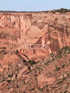 view of a cliff and stones. - Image of a cliff and stones.