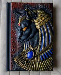 A couple of new dragon books I've made! The covers are attached to very nice sketchbooks with white paper, perfect f… Polymer Clay Art, Handmade Polymer Clay, Book Cover Art, Book Art, Book Covers, Book Sculpture, Handmade Books, Egyptian Art, Journal Covers