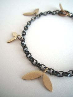 Leaf charm bracelet | Contemporary Bracelets by contemporary jewellery designer Kate Smith (via Dazzle exhibitions)