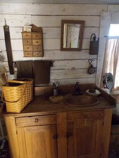 Rustic bathroom cabinet and sink-- add some rustic elements to this.