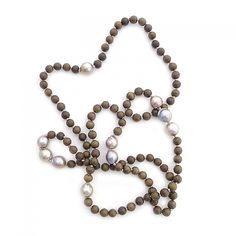 knotted gray wood & baroque pearls $350.00  Hand knotted 8mm Gray Wood mixed with large 12-14mm Baroque Pearls  Details::     38″ long