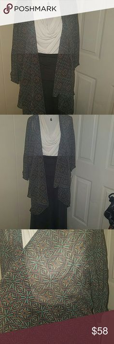 """Lularoe 'LINDSAY ' Size SMALL ' UNICORN *NWT* Lularoe 'LINDSAY ' KIMONO ' (They run a little bigger than true to size ) Brand new with tag attached in size SMALL . BEAUTIFUL PIECE AND COLORS,  UNICORN SOUGHT AFTER PRINT,  3/4 """" SLEEVES.. VERY NICE AND SHEER FABRIC.. ( MAXI SKIRT/dress sold separately also is necklace... mannequin and top for example only) LuLaRoe Tops Blouses"""