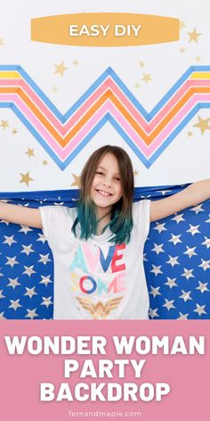 This DIY Backdrop for a Wonder Woman 1984 Inspired Party is so easy to make with colored masking tape! Get all of the details for this girl power superhero kids party photo booth now at fernandmaple.com!