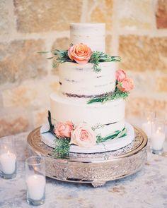 Three tier semi naked wedding cake adorned with flowers #wedding #weddingideas #weddingcake