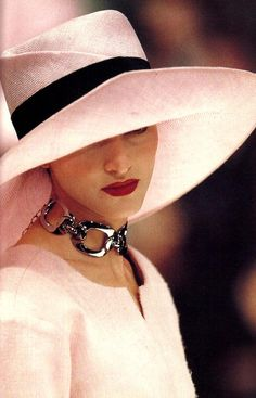 CHRISTIAN DIOR. Per another pinner: Love the hat. For all my hat-love I rarely wear one, but oh, do I love elegant hats on women with short hair or with their hair up. The hat should take the place of the hair and not compete. A hat should be on its own framing the face. as it does here.