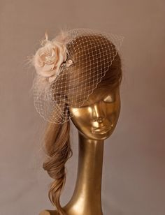 Hey, I found this really awesome Etsy listing at https://www.etsy.com/listing/158687535/champagne-birdcage-veil-with-flower