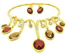 Set placat cu aur 18k , pietre semipretioase si cristale Swarovski, format din colier si cercei, deosebit de rafinat si elegant, cu o realizare de exceptie. www.bodyandbijoux.ro