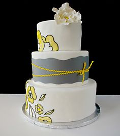 gray and yellow wedding cake-  Like the paisley an am thinking on the guys vest as well.....