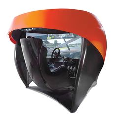 """The Full Immersion Professional Racer's Simulator. It's the only racing simulator with a 180°, 106""""-wide HD screen that immerses the driver in a high-speed virtual car race of unparalleled realism. Designed with manufacturer Ariel Atom sport cars. $65,000 @ Hammacher Schlemmer"""