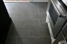 12x24 tile floors | have porcelain tile with creamy cabs and soapstone, and I love it ...