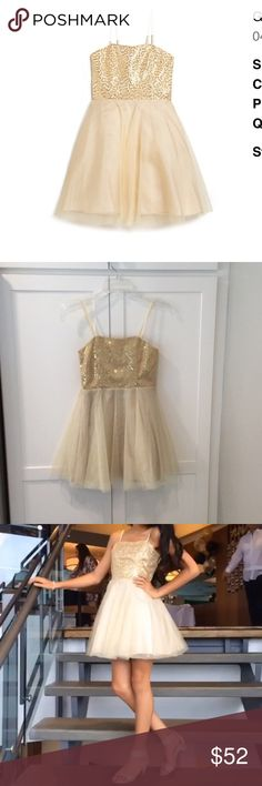 Un Deux Trois Gold Sequin Dress Sparkly! This adorable gold dress in size 10 looked so good on my daughter for her 6th grade promotion party! Short tulle with Sequin Top is the Perfect party dress. bar/bat mitzvah, graduations, wedding, or any other special event. Please note very faint stain (it's not noticeable) on tulle. My daughter wore this last year when she was 12; so can probably run 10/12 years old.. I also have the coordinating shoes worn with that dress. Check it out in my closet…
