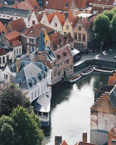 A beautiful areal shot over the Rozenhoedkaai area in Bruges. You can relax here with a beer, enjoy a canal ride or even get some handmade Belgian chocolate – you can see why it's so popular! Belgian Chocolate, Get Some, Most Romantic, Anastasia, Amsterdam, Shots, Bucket, Relax, Beer