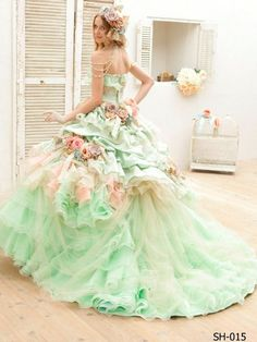 The colors in this dress are amazing and the flowers add the perfect touch!