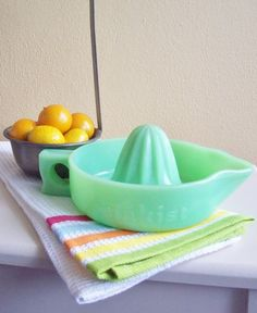 Sunkist jadite juicer/reamer - I bought one of these about 16 years ago. It's one of my favorites.