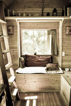 Tiny house tiny house, tiny house interior. Livin small is easy in this tiny house. ~ The space under the bench could be pulled up with a pull out leg to double the size...seating cushion could be doubled up until it's expanded.