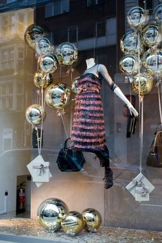 Xmas Windows - love the idea of balloons lifting gifts and cards, floating up