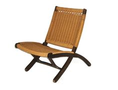 danish modern folding corded chair. there are matching footstools.