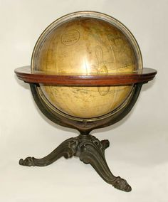 Franklin/ H.B. Nims 10-Inch Terrestrial Table Globe, Troy, New York: c. 1880-90 on a tripod iron stand, with foliate cabriole legs and a printed horizon band and zodiac.