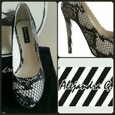 "🍒Final Price🍒🆕💯% Authentic Python Heels Super sexy 100% Authentic Alejandra G. Snake Skin with Net Overlay High Heel Shoes. Sexy black and white striped bottoms. 5 1/2"" Heel with 1"" platform. 100% Real Python Snake Skin. Comes with box, extra heel tips and dust cover. Brand New, never worn. Definitely a sexy one of a kind shoe. Size 8M. New in Box (same as NWT). Made in Italy. Super sexy and beautiful in person! 2 Times HP😍 Stunning in person, Paid $1200.00 + tax. Any questions please…"