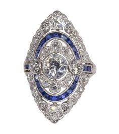 Art Deco Shreve & Co. #diamond, #sapphire and #platinum ring centering one old European cut diamond weighing approximately 0.90 ct., accented by (33) old European cut and (1) single cut diamond weighing a total of approximately 1.90 cts., further enhanced by (22) calibre-cut sapphires weighing a total of approximately 0.64 ct., set in a hand pierced and millgrained platinum mounting, size 6 1/2   |   #ArtDeco #Art #Deco #Jewelry  September 20th #Auction from @alanna1307