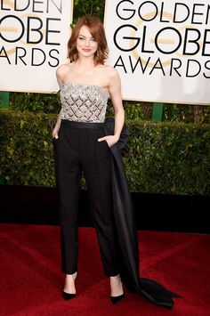 Emma Stone wowed the crowd in a Lanvin jumpsuit, which was adorned with an oversize bow on the back. Even in pants, she made our Golden Globes best dressed list, and we're already deeming her outfit one of this award season's best.