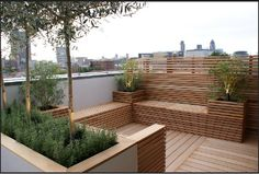 Charlotte Rowe Garden Design. Love the practical and chic idea for a very small garden. Full enjoyment and minimal maintenance.