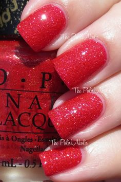 "OPI's ""Magazine Cover Mouse"" nail polish from OPI's Couture de Minnie Collection.  Amazing and beautiful red liquid sand with pink and gold shimmer. So pretty and perfect especially over the holidays!"