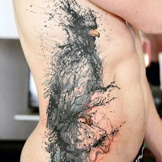 Man With Abstract Ink Splash Tattoo On Side