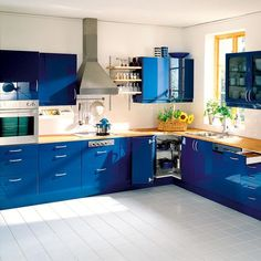 Captivating Blue Kitchen Design Ideas : Modern Kitchen Interior Design With Blue Cabinets And Stainless Steel Extractor Hood As Well As Microwave Wall Cabinet White Floors Blue Kitchen Designs, Kitchen Color Trends, Blue Kitchen Decor, Kitchen Colour Schemes, Kitchen Room Design, Kitchen Cabinet Design, Modern Kitchen Design, Kitchen Colors, Kitchen Interior
